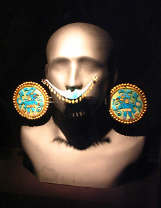 LIMA, PERU - Another display of the elaborate ear and nose ornaments worn by native Peruvian cultures at the time of the Spanish conquest. The exhibit is at the Museo Arqueologico Rafael Larco Herrera