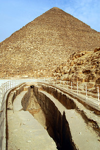 A RIVER CRUISE TO THE AFTERLIFE? - Southeast of Khufu's Pyramid, the site resembles an ancient dried-up river port.  Five boat pits have been discovered.  Two were covered by slabs of limestone, and beneath them were two large, disassembled wooden boats.