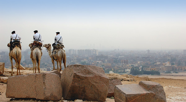 GIZA PLATEAU - The pyramids used to rest in peace and dignity far from the nearest town. But the growth of Cairo had to be done in southern direction where there was room.  Today the city's sprawling surburbs have been built to the very edge of the pyramids.