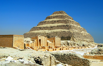 SAQQARA – THE FIRST PYRAMID:  The day after arriving in Egypt, we traveled about 15 miles south of Cairo through the palm-lined Nile floodplain to the edge of the western desert.  Our first stop was appropriately the place where the Age of the Pyramids began: the royal necropolis of Saqqara.