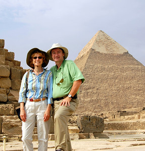 """GIZA PLATEAU - In our early morning visit to the Pyramids, we took advantage of the lack of crowds to set up a self portrait -- a possible """"we were there"""" photo for this year's Christmas card."""