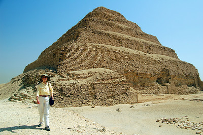 SAQQARA - We walked the full length of the perimeter of the pyramid, wondering what would possess a king to build not just one mastaba (a box-like grave marker) but six, one on top of the other.  There are corridors inside the pyramid leading below its surface.  But the pharaoh and his buried riches have long since disappeared.