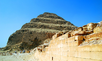 SAQQARA - The Step Pyramid was much larger than we had imagined, rising some 204 feet.  It was bounded by a finely cut limestone wall originally 34 feet high.  This complex once included vast open courts, pavilions, shrines, and chapels.
