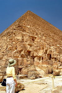 GIZA PLATEAU - Khufu (or Cheops, as the Greeks called him) enlisted 30 to 50,000 of his closest friends to build his pyramid over 20 years beginning around 2540 BC. For the next 4,000 years it was the tallest structure in the world, rising 481 feet (now only 455 feet with erosion and the removal of its topmost layer).  The Pyramid covers over 13 acres and contains nearly 90,000,000 cubic feet of masonry, enough to build 30 Empire State Buildings.