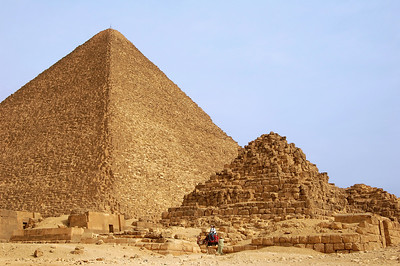 """QUEENS' PYRAMIDS - These smaller  pyramids were built for members of the pharaoh's familty, although the actual identify of the occupants is unknown.  An ancient tale told by the Greek historian Herodotus claims that to raise funds for building the Great Pyramid, Khufu forced his daughter to work as a prostitute.  She could, however, collect a single stone from each """"client"""" to build her own pyramid.  Perhaps Herodotus exaggerated – if one of these is indeed the pyramid of Khufu's daughter, it contains more than 100,000 stones."""