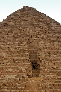 THE GREAT GASH - In the 12th century one of Cairo's sultans attempted to dismantle Menkaure's pyramid.  After eight months, the project was abandoned, merely having achieved the vertical scare visible on the north face.