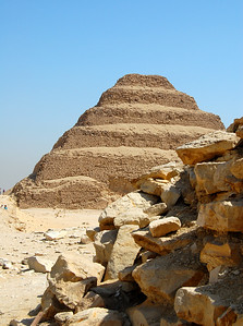 SAQQARA - The Step Pyramid was built for King Djoser by his high priest Imhotep in the 27th century BC.  It was an impressive leap forward in architecture.  Imhotep's great innovations were not only the pyramid-like design, but his decision to use stone in place of mud brick.  Imhotep was also apparently one of history's first physicians as well as the self-proclaimed inventor of the papyrus scroll.  Two thousand years after he built the Step Pyramid, Imhotep would be deified by the ancient Egyptians.