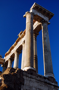 ANCIENT ROME - The Temple of Saturn:  these columns once framed the entrance to the Forum's oldest temple (497 BC).  Inside, the story is told, was a wooden statue of the god Saturn, old and decaying.  But within the statue's pedestal, the ancient Romans stockpiled the gold bars, coins, and jewels of their state Treasury.
