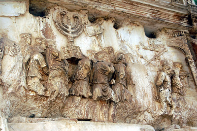 ANCIENT ROME - One of the marble panels on the Arch of Titus depicts the Romans carrying off a menorah and other loot from Jerusalem.  The treasure gave emperor Vespasian the resources to build the Colosseum.