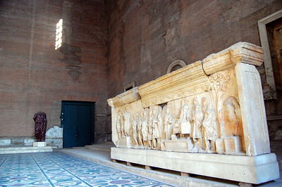 ANCIENT ROME - Here, inside the Curia, 300 senators elected by the citizens of Rome, would meet to debate and create the laws of the land.  Once there would have been three tiers of wooden seats encircling the mosaic marble floor.  Today, a lonely statue at one end and scattered pieces of carved reliefs have been placed inside to provide a partial image of the interior.