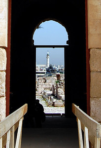 AMMAN - A view of one of Amman's many minarets framed by the doorway of the Al-Qaser on Citadel Hill.