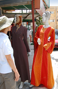MADABA - During our walk through Madaba, Jeanne was intriqued by this particular outfit, but wasn't sure that it was her color.