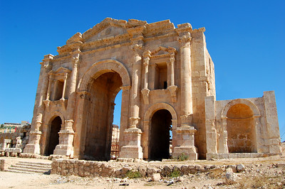"""JERASH - An hour's drive north of Amman is the ancient city of Jerash.  As we approached,  we were greeted by the imposing Triumphal Arch built to honor the Roman emperor Hadrian's arrival at Jerash in AD 129.  Jerash (""""Gerasa"""" in ancient times or in the Bible as """"the region of the Gerasenes"""" ) is one of the largest and best preserved examples of ancient Roman architecture in the world."""