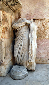 AMMAN - Tucked away in one corner of the amphitheater, we came upon this carving from the heydays of the ancient Roman occupation, now unceremoniously missing its head and no longer standing on its pedestal.