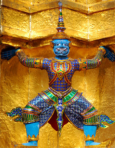 BANGKOK - A colorful Khon figure guards a stupa at the Grand Palace.