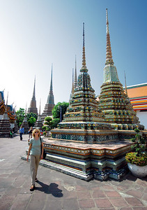 BANGKOK - Jeanne walks through several of the smaller chedis in an inner courtyard at Wat Pho.