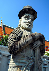 BANGKOK - These statues were carved from stone ballast used in the rice barges that once plied the Chao Phraya river. We could understand the Chinese influence, but the jaunty top hats still seemed a little out of place.
