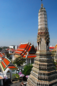 BANGKOK -  By climbing the staircase midway up Wat Arun's central prang, the distinctive rooflines of the other buildings in the wat could be seen.
