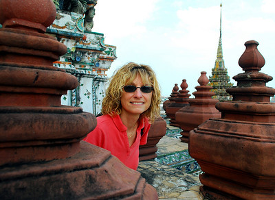BANGKOK - Jeanne peers out over the landscape from midway up Wat Arun's central prang.
