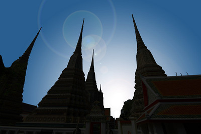 BANGKOK - The soaring silhouettes of the spires at Wat Pho.  The four largest chedis - bell-shaped monuments - honor the first four kings of Thailand.