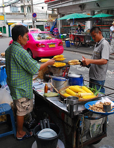 "...where roadside vendors jealously guard valuable sidewalk space for foodcarts and makeshift ""diners."""