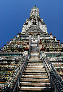 BANGKOK - Viewed from a distance, Wat Arun's prang - as well as its surrounding structures - appear to be a dull grey. . .