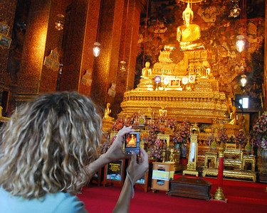 BANGKOK - Jeanne shoots a photograph of the Buddha image at Wat Traimit.  (We found that most wats allow photographs to be made of their Buddha images - with the notable exception of the Emerald Buddha.)