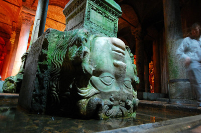 """ISTANBUL - The two heads - called the """"Medusa Heads"""" - were revealed when the water level was lowered during a major restoration of the Basilica Cistern in 1987.  It is likely that the heads were brought to the cistern after being removed from an antique building of the late Roman period. Scientists generally agree that they were placed sideways and upside down deliberately, but no one knows why."""
