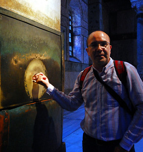 """ISTANBUL - At one corner of the Hagia Sophia is the """"crying pillar"""" with a hole surrounded by a bronze band.  Legend says if you put your finger in the moist hole and spin around, your wish will be granted."""