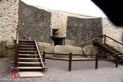 Entrance to New Grange.  ( My camera 'raincoat' is shadow in upper right :(  )