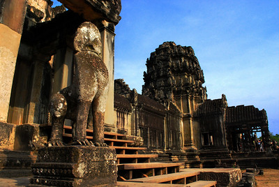 ANGKOR WAT: ACT II - Then Act II unfolds as you enter the West Portico, passing the giant stone lions guarding its doorways.  At many ancient ruins, this impressive structure might have been the star attraction.  But at Angkor Wat, it is only one of four gateways.