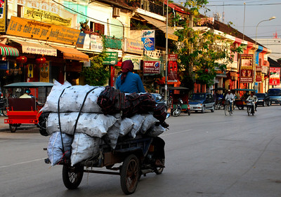"""SIEM REAP - The name """"Siem Reap"""" means the 'Defeat of Siam' - today's Thailand - and refers to a centuries-old bloodbath.  But as old as Siem Reap is, it still resembles a frontier village with a heafty dose of resort town thrown in."""