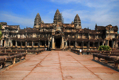 ANGKOR WAT - ACT IV, THE CLIMAX:  There before us, the dramatic climax, the postcard view of Angkor Wat, the image on the Cambodian flag, the Hindu's symbolic tribute to Mount Meru, the core of the universe where the world began.  But hey, since when does the center of the universe have scaffolding!