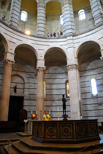 Inside, the Baptistery is spacious but simple, almost austere.  But there are some who believe the design had other purposes than simply to house the octagonal font for baptizing.  Recent computer analysis suggests that the 15th century architects who built the 250-foot-wide dome intended the building to be not just a baptistery but also a musical instrument.  From the baptismal font, a priest (or today a security guard) can sing a note and it will echo for a good 10 seconds - making it possible for a person to sing harmonies with himself.