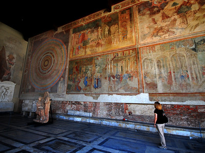 Once the interior walls of the arcade were painted with colorful frescoes.  In the summer of 1944, however, during World War II, the Camposanto Cemetary was hit by an American incendiary grenade duriing an artillery battle between the Allies and Germans.  The heat peeled many of the historic frescoes from the walls.