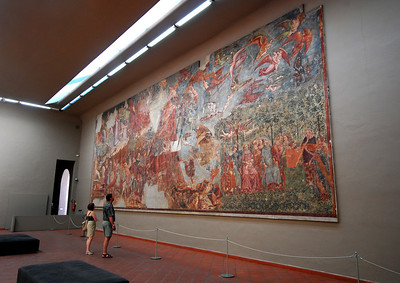 Some of the restored (but badly damaged) frescoes have now been relocated into an adjoining exhibit room, including the 1000-square foot Triumph of Death, which depicts the calamity of the bubonic plague in 1348 that killed one in three Pisans.
