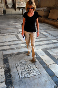 The arcade floor is paved with the coats-of-arms of some 600 departed Pisans, and amazingly, very few of the engravings were protected from the thousands of visitor's feet that have worn down much of the detail over the last few hundred years.