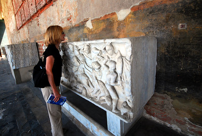 There's been a cemetary on this spot since the days of the Roman Empire, and around the arcade there are dozens of ancient Roman sarcophagi.  Jeanne checked to see if any still held any dead Romans.
