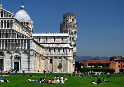 The emerald lawn of Il Campo dei Miracoli - The Field of Miracles - was filled with sun-seeking tourists.