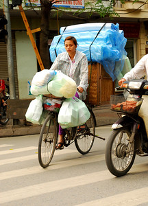 Bicycles are piled high with goods being delivered to local shops.