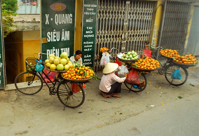 Some vendors still rely on bicycles as mobile markets for their fruits and produce.
