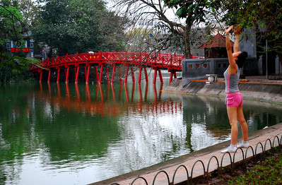 Hoan Kiem Lake is the setting for an early morning ritual that seems uniquely Vietnamese.  Before dawn, the young and the elderly by the hundreds began gathering at the lake to exercise...