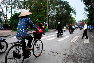 "PEDESTRIANS BEWARE - There is a ""rule of the road"" in Hanoi:     To cross a street, walk resolutely and slowly.  Don't stop.  The bicyclists and motorcylists are skilled drivers, they will anticipate your pace and swerve to miss you.  And one other thing - crosswalks mean absolutely nothing."