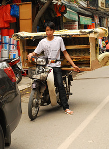 And when we thought we had seen everything, we came across this delivery boy with, yes, a sofa strapped to his motorscooter.