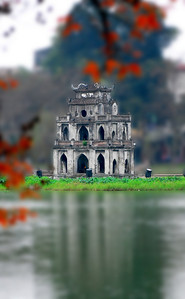 LOCH NESS MEETS KING ARTHUR - The picturesque centerpiece of Hanoi is Hoam Kiem Lake, just a few blocks from our hotel.  A tiny pagoda on an islet honors the legend of a 15th century giant turtle that miraculously rose from the waters to first deliver, then reclaim a magical sword that the Vietnamese emperor used to vanquish the Chinese.