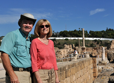 "Overlooking the Baths of Antoninius Pius, we posed for our first ""We Were There"" self-portraits.  (Note:  the white wall in the background marks the perimeter of the Prime Minister's compound.)"
