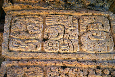 As we ascended the steps of the pyramid, we came across well-preserved glyphs, the ancient text of Mayan writing.