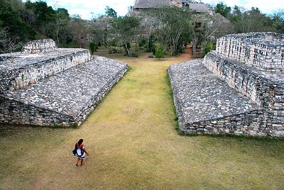Virtually every Maya site has a structure like this -- it is an ancient ballcourt.  Little is known about the rules of the game except that the objective was to strike a rubber ball through stone hoops mounted on the walls (missing at this ballcourt).