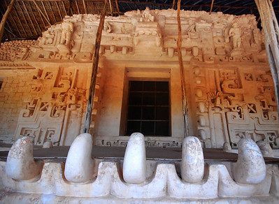 """The centerpiece of the gigantic frieze is the largest, best-preserved, and most dramatic of Mayan monster-mask temple entrances, the giant-toothed jaw of the """"Witz"""" monster.  It is actually the entrance to the tomb of Ek'Balam's most venerated ruler, Ukit Kan Le'k Tok'."""