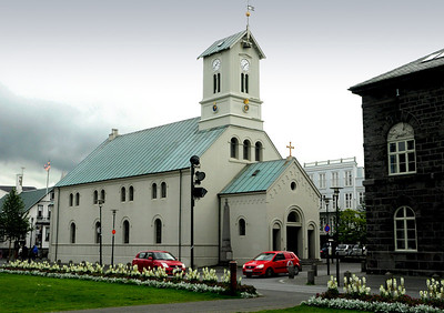 Next to the Parliament is the Dómkirkjan. There has been a church on this site since around 1200 AD. The current church was completed in 1796.  It was here that  Icelandic independence was first officially endorsed by the Lutheran church of Iceland. Since 1845, members and cabinet ministers of every parliament have gathered here before the annual session. It was also in this church that Iceland's national anthem  was first sung in 1874.